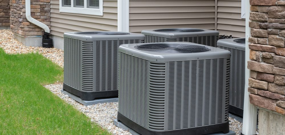 four air conditioners running outside of a home in northern colorado